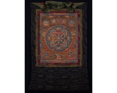 Vintage mandala thangka with brocade